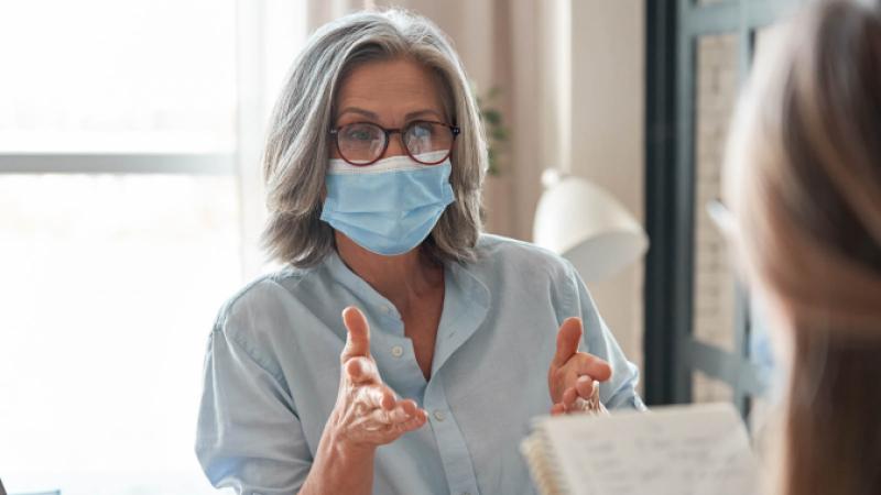 Lady in mask talking