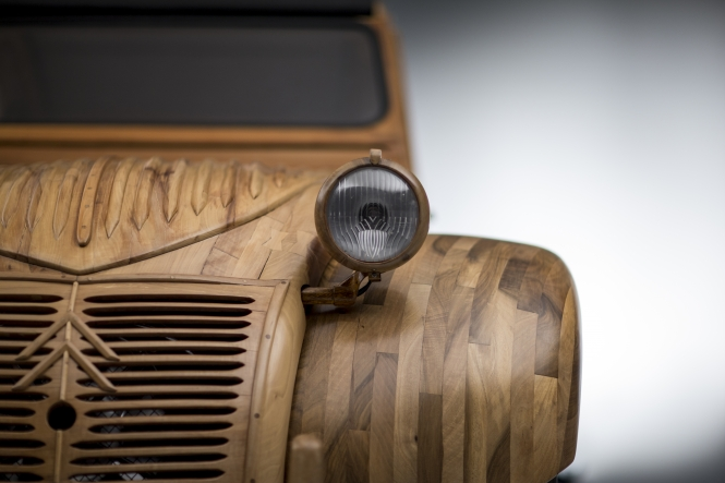 wooden 2CV car with glass headlight