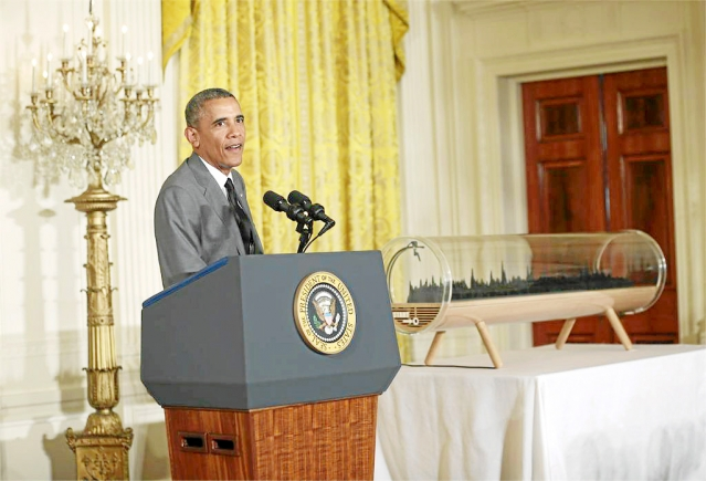 US President Barack Obama with the 3D printout sculpture of his own voice