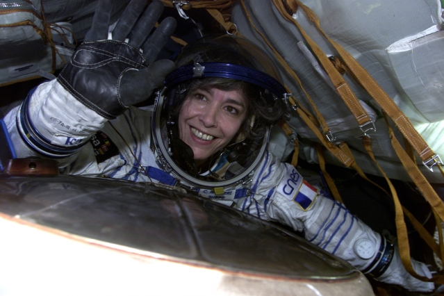 Astronaut Claudie Haignere waves from Soyuz
