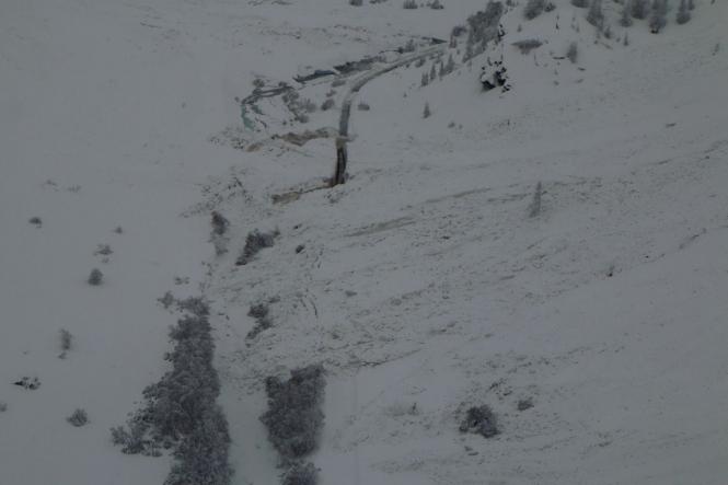Dark view of avalanche cutting road in Savoie