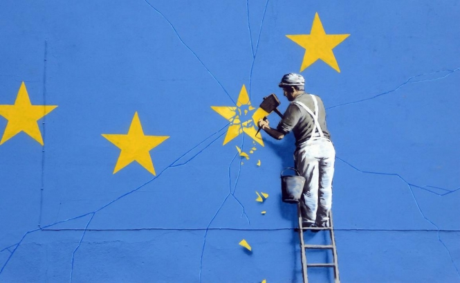 Blue Europe flag with man chipping off a yellow star