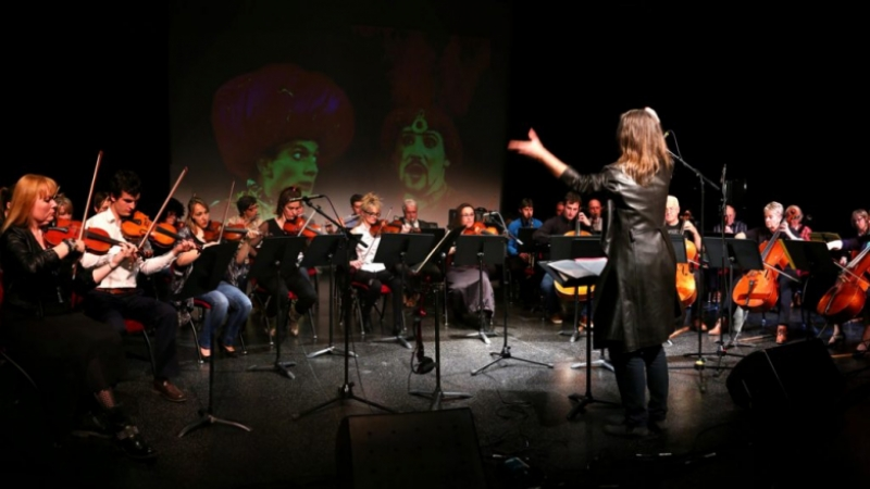 Orchestra with leader on right