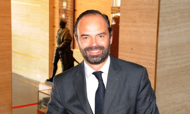 Smiling bearded man in suit and tie, Edouard Philippe