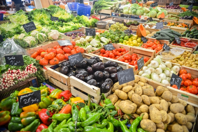 Wide range of fruit and veg laid out at market