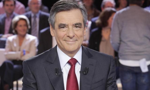 François Fillon - former French prime minister smiles in front of TV audience