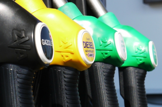 Line-up of fuel pumps, black, yellow and two green