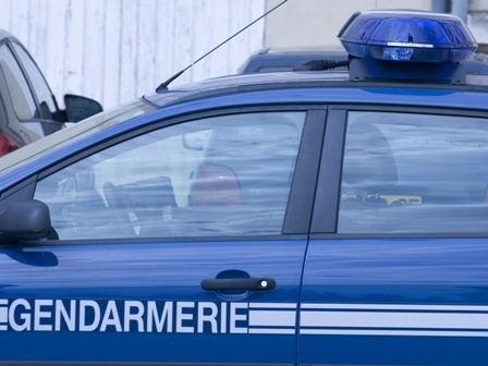 Gendarmerie blue car with blue light on roof