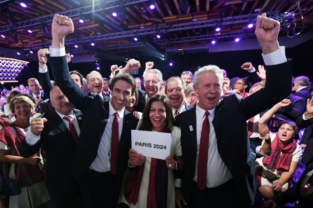 Cheers from people with Paris 2024 text