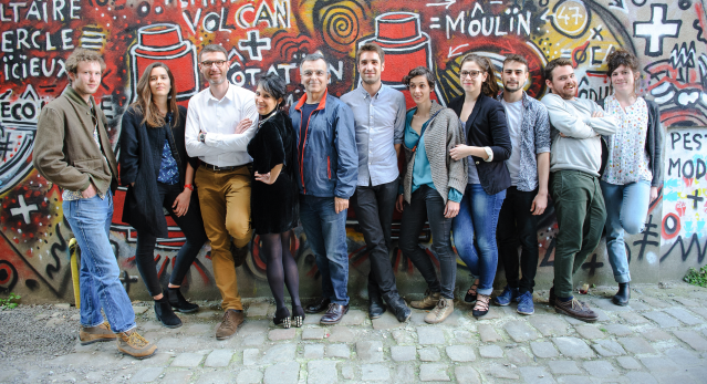 Artists from Les Réalisateurs art/business group in Nantes in front of graffiti wall