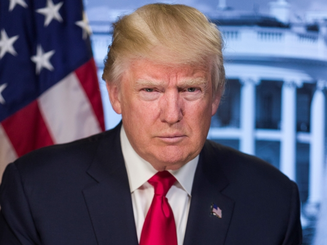 President Donald Trump with Stars and Stripes in background