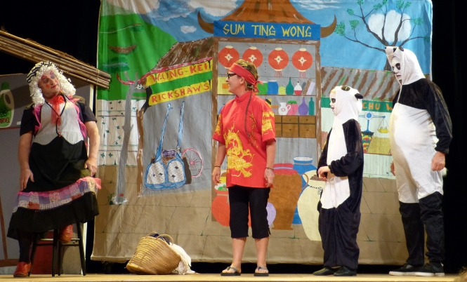 A scene from the pantomime Aladdin, performed by the 64 Players Association in 2015