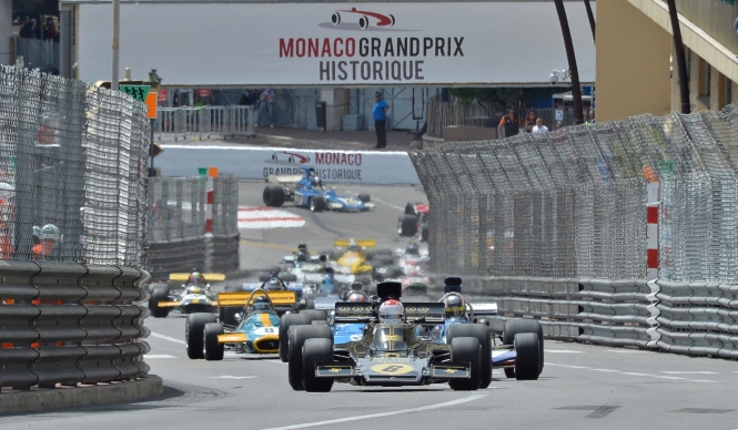 Vintage F1 cars racing around the Monaco Grand Prix course