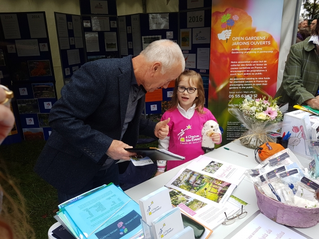 Open Gardens / Jardins Ouverts founder Mick Moat with six-year-old cancer survivor Orane