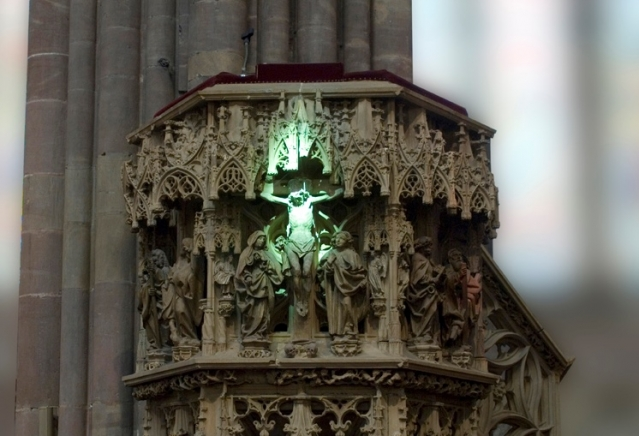 Green light falls on the altar at Strasbourg Cathedral for spring equinox