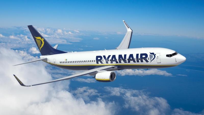 Ryanair jet in flight with blue skies and cloud