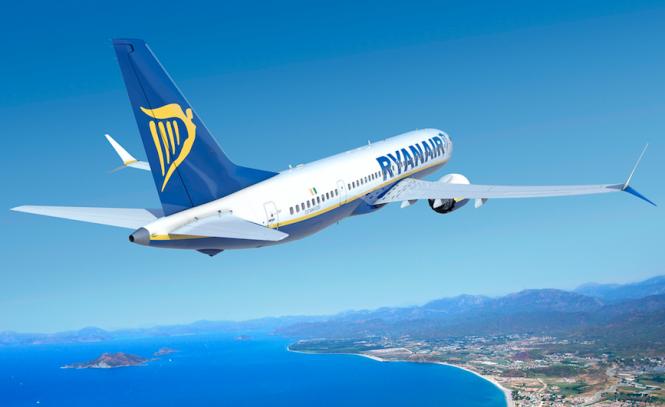 Ryanair jet climbing over sea and land blue sky