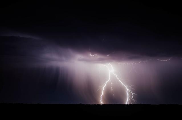 Lightning strikes in dark sky