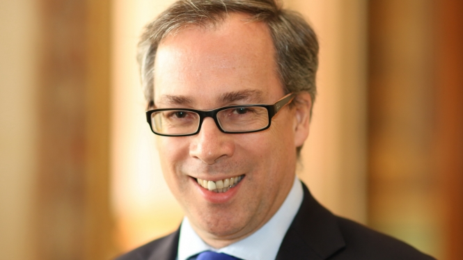 Head shot of British ambassador to France Ed Llewellyn smiling