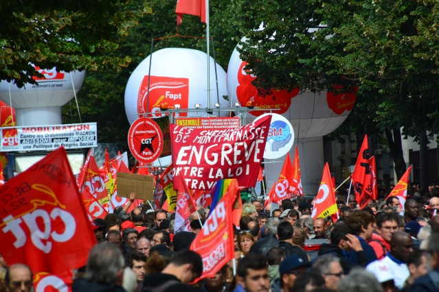 CGT union flags and banners during a protest march against labour reforms in France