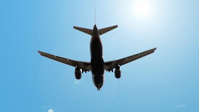 aeroplane seen from below against blue sky