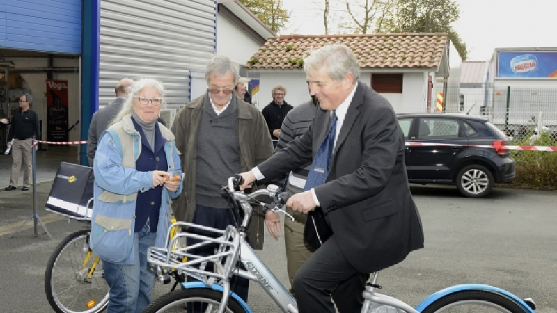 Man in a suit on a hydrogen-powered bicycle