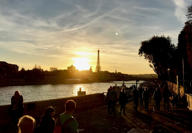 Eiffel Tower and Paris skyline from across the Seine as the October sun goes down