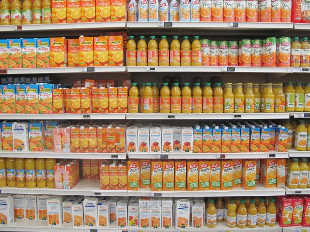 Cartons and bottles of orange juice for sale in a French supermarket