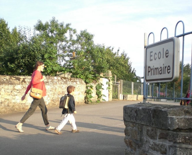 Parent and child walking into school