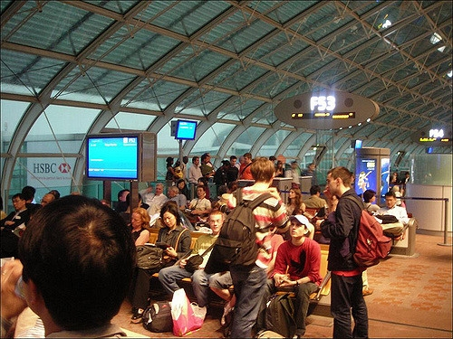 Passengers waiting to board a flight out of Charles de Gaulle airport