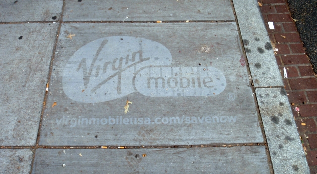 A paving slab with an advert for a mobile telephone operator
