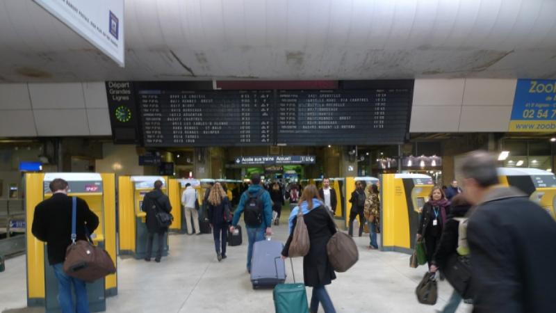 Rail passengers heading towards the platforms at Gare Montparnasse, Paris