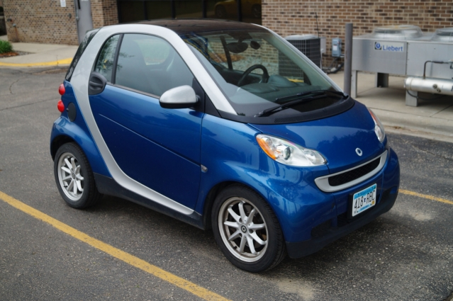 A blue Smart Fortwo car