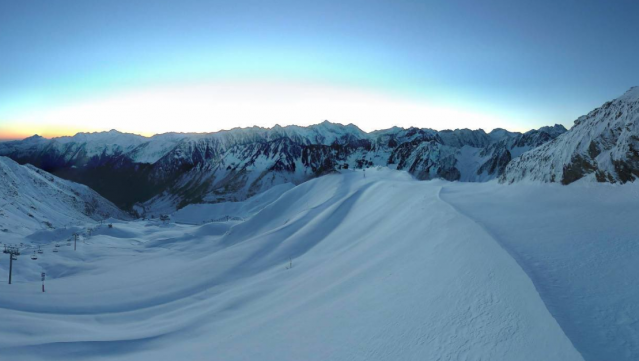 Sunrise over the Pyrenees mountains, which are covered by a fresh fall of snow