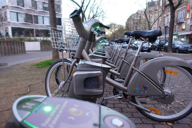 Grey velib' bike share cycles at a stand in Paris