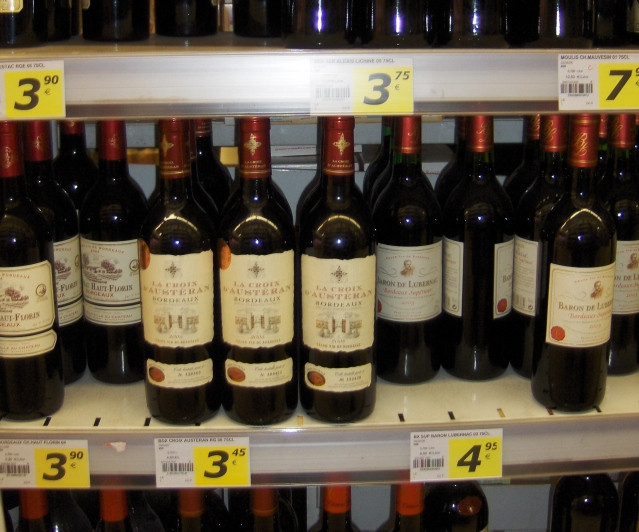 wine on a shelf in a French supermarket