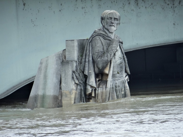 Statue of a 19th-century French soldier on the Pont de l'Alma in Paris, up to its waist in water as the Seine floods